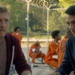 New Cobra Kai season 4 trailer reveals final release date Johnny Lawrence and Daniel LaRusso at a table in a prison in Cobra Kai, which returns to Netflix in 2021.